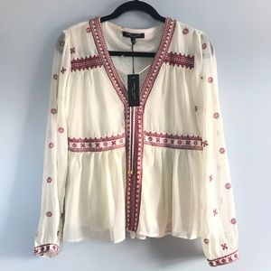 Romeo + Juliet Couture embroidered blouse size M.